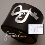 Your son's dragon turns into a cool gift! Dragon leather cuff