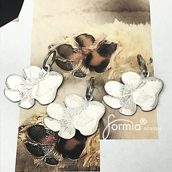 3 paw print key chains from photo