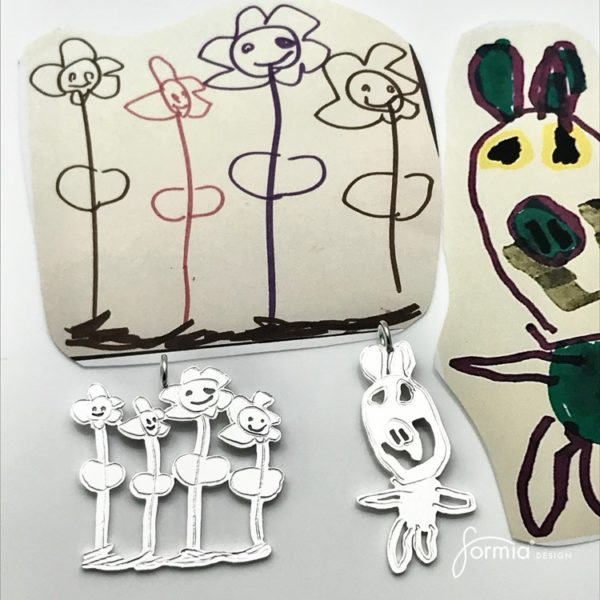 Artwork pendants design from flowers and a pig drawing