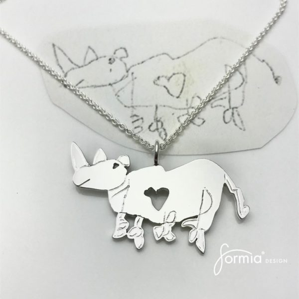 Kids drawing of animal rhino made into a silver artwork pendant