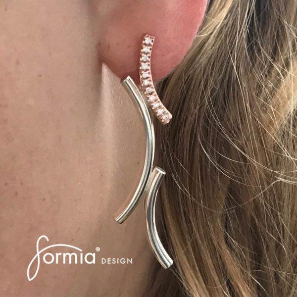 Kurvene diamond earrings on ear