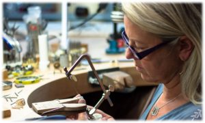 jewelry design by kids Goldsmith Mia van Beek working on custom jewelry at her bench