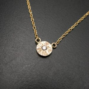 Textured disc pendant necklace in gold and diamond