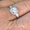 diamond halo engagement ring cushion shape on finger