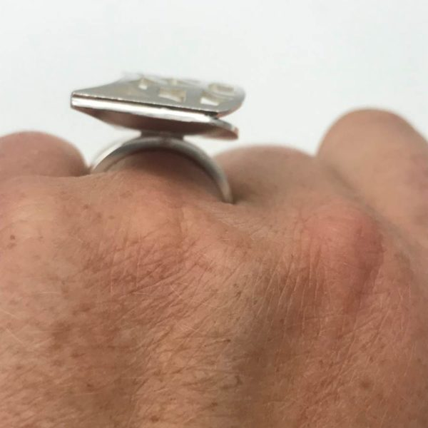 Flame ring on the hand, edgy design of handmade jewelry