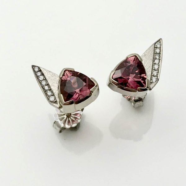 Stud earrings with pink trillion cut torumalines and bead set diamonds