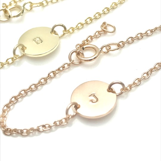 new baby girl gift bracelet up close 14k gold bracelet with fisrt letter of name