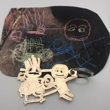 Chalk art turned into bronze keychain